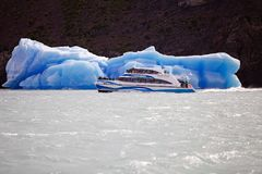 Iceberg and tourist boat in the Argentino Lake, Argentina Royalty Free Stock Photography