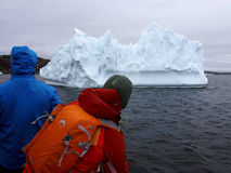 ICEBERG_TOURISTS. Passengers on tour boat get a closeup look at a giant iceberg near St. Anthony, Newfoundland during that town`s annual iceberg festival in June Royalty Free Stock Photos