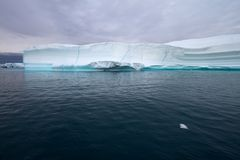Iceberg with turquoise line Stock Photo