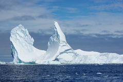 Iceberg with two vertices. Iceberg with two vertices floating in the ocean Royalty Free Stock Photo