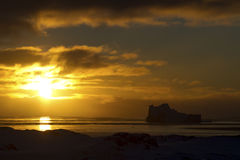 Iceberg and waters of the southern ocean at sunset Stock Photos