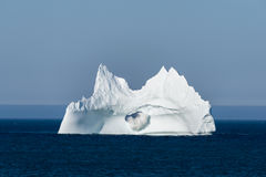 Iceberg with a Wave Crashing Through Large Hole, Newfoundland Stock Photos