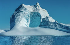 Iceberg With A Huge Cave At The Mouth Of The Icefjord In Ilulissat, Greenland Stock Photos