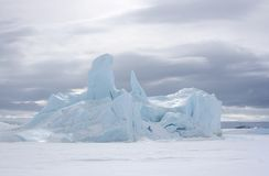 Icebergs on Antarctica. Iceberg frozen solid in the sea ice of Antarctica Royalty Free Stock Photography