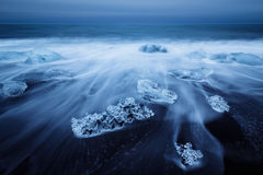 Icebergs beached on jokulsarlon beach in Iceland. Long exposure stock images