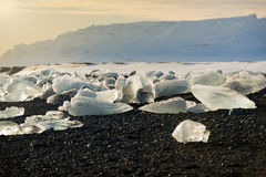 Icebergs on the black sand beach during sunset, Iceland Stock Photos