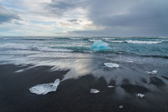 Icebergs on a black sand Jokulsarlon beach, Iceland Royalty Free Stock Photos