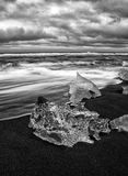 Icebergs at Blank Sand Beach, Iceland. Long Exposure monochrome shot of the icebergs and water at Black Sand Beach, Iceland Royalty Free Stock Images