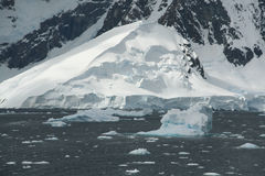 Icebergs, brash ice, mountain icefall. And glacier,Lemaire Channel,Antarctica Stock Image