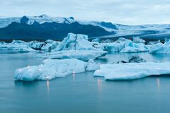Icebergs with candles, Jokulsarlon ice lagoon before annual firework show, Iceland Stock Photo