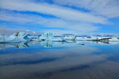 The icebergs and cirrus clouds Stock Image