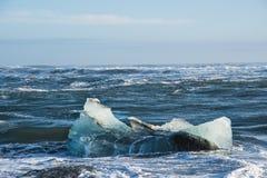 Icebergs on the coast of Diamond beach near Jokulsarlon in South Iceland. On a cold windy day stock image