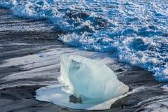Icebergs on the coast of Diamond beach near Jokulsarlon in South Iceland. On a cold day stock photography