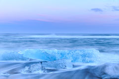 Icebergs at crystal black beach in Iceland Royalty Free Stock Images
