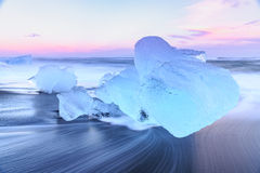 Icebergs at crystal black beach in Iceland Stock Photography