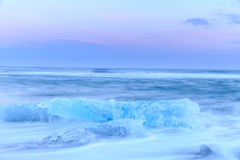 Icebergs at crystal black beach in Iceland Royalty Free Stock Image