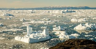 Icebergs drifting in the fjord next to Ilulissat, Greenland.  stock image