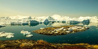 Icebergs drifting in the fjord next to Ilulissat, Greenland.  stock photo