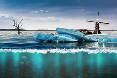 Icebergs on the farm lands. Derived icebergs and marine lives on the Dutch farm lands and dead tree concept stock photography