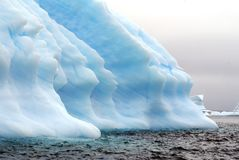 Icebergs in the frigid waters of Antarctica. Icebergs grounded in a bay in the frigid waters of Antarctica royalty free stock images