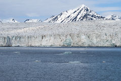 Icebergs in front of the glacier, Svalbard, Arctic Royalty Free Stock Image
