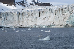 Icebergs in front of the glacier, Svalbard, Arctic Stock Photos