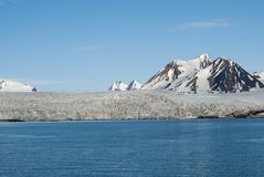 Icebergs in front of the glacier, Svalbard, Arctic Stock Photo