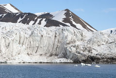 Icebergs in front of the glacier, Svalbard, Arctic Royalty Free Stock Images