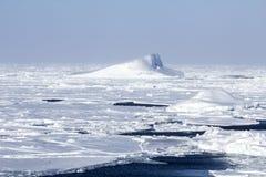 Icebergs and frozen ocean. Icebergs at frozen polar seas and vast ice floes Stock Photo