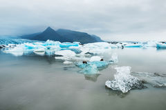 Icebergs in the glacial lake with mountain views Stock Photo