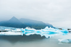 Icebergs in the glacial lake with mountain views Stock Photos