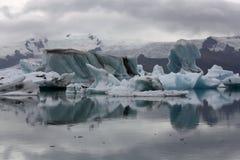 Icebergs on the glacier lagoon Jokulsarlon. At the glacier lagoon Jokulsarlon in Iceland on a rainy summer day Royalty Free Stock Photo