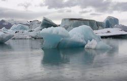 Icebergs on the glacier lagoon Jokulsarlon. At the glacier lagoon Jokulsarlon in Iceland on a rainy summer day Stock Images