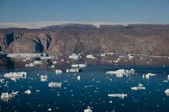 Icebergs - Scoresbysund Fjord - Greenland. Scattered icebergs in a Greenland fjord Stock Photo