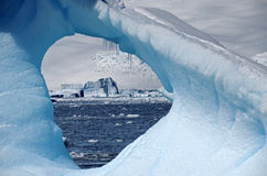 Icebergs through the ice, Antarctica. Sculptured ice in a field of icebergs Royalty Free Stock Photography