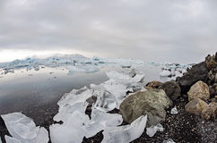 Icebergs. Ice boulders and rocks on the shore  at Jokulsarlon Glacier lagoon in southern Iceland Stock Image