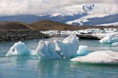 Icebergs at Jokulsarlon ice lagoon and view to the glacier, Vatnajokull National Park, Iceland Stock Photos