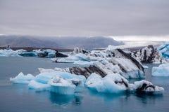 Icebergs in Jokulsarlon lagoon beneath Breidamerkurjokull glacier Sudhurland, Iceland royalty free stock images
