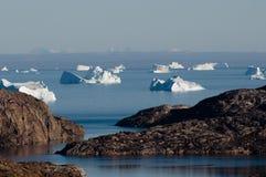 Icebergs - Scoresbysund Fjord - Greenland. Icebergs leaving fjord into the sea Stock Photos
