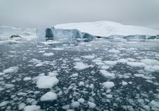 Icebergs melting on arctic ocean. In greenland royalty free stock images