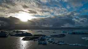 Icebergs are melting at Jokulsarlon glacier lagoon at sunset Stock Photography