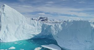 Icebergs melting at sea aerial. Nobody nature, environment and landscapes of Antarctica ocean bay