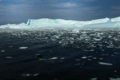 Icebergs, one with blue stripe Stock Image