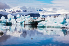 Icebergs are reflected in the mirrored water Stock Image