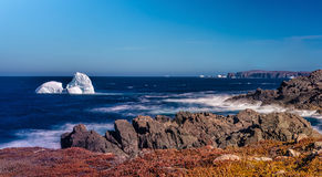 Icebergs and Rugged Coast, Newfoundland, Canada stock photo