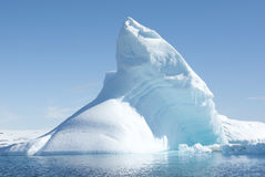 Icebergs in the solar glare. Icebergs in the sunny bright light on the background of the island Stock Images