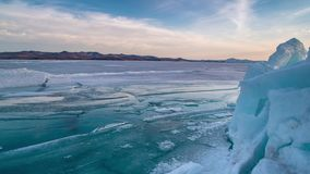 Icebergs During Sunset in Glacier Lagoon on lake Baikal. Melting and breacking ice, icebergs Glacier Lagoon on lake Baikal stock video footage