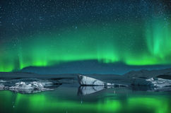Icebergs under the Northern Lights. Northern Lights over the Jokulsarlon Glacier Lagoon in Southern Iceland