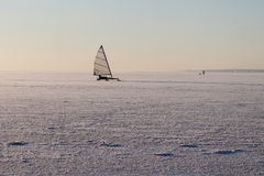 The iceboat sliding on a surface of the frozen river Stock Image