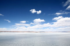 Icebound Lake. Blue sky and white cloud Stock Photos